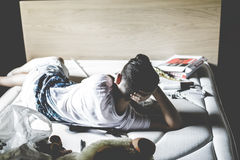 Sad child lying alone in a empty room Stock Photography