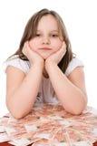 Sad child with money ruble Stock Photos