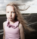 Sad child near road Stock Images