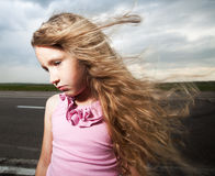 Sad child near road Royalty Free Stock Photography