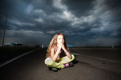 Sad child near road Royalty Free Stock Photos