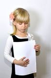 Sad child with notebook Royalty Free Stock Photography