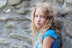Sad child outdoors stock images