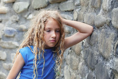 Sad child outdoors Royalty Free Stock Image
