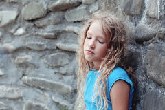 Sad child outdoors Stock Photo
