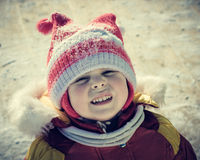 The sad child outside. In the winter Royalty Free Stock Photos