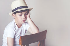 Sad child. Sad and pensive child with hat Stock Photography