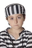 Sad child with prisoner costume Royalty Free Stock Image