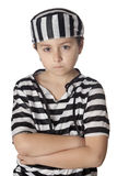 Sad child with prisoner costume. Isolated on white background Royalty Free Stock Photography