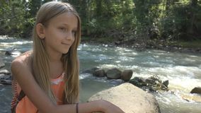 Sad Child by River, Thoughtful Kid Relaxing in Nature, Girl in Camping, Mountain royalty free stock photos