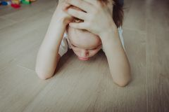 Sad child, stress and depression. Bored and tired royalty free stock image