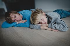 Sad child with stressed father, family problems, sorrow. Sad child with stressed father at home, family problems, sorrow royalty free stock photos