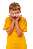 Sad child teen blond boy in yellow shirt is Stock Photos