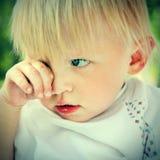 Sad Child. Toned Photo of the Sad Child Portrait outdoor stock photos