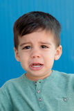 Sad child with two years crying. On the street royalty free stock images