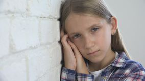 Sad Child, Unhappy Kid, Sick Ill Girl in Depression, Stressed Thoughtful Person royalty free stock photo