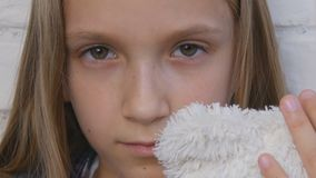 Sad child, unhappy kid, sick ill girl in depression, stressed thoughtful person.  stock footage