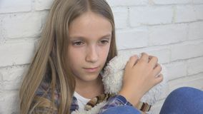Sad Child, Unhappy Kid, Stressed Ill Girl in Depression, Sick Abused Person stock photo