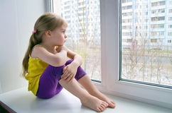 Sad child at the window Royalty Free Stock Photo