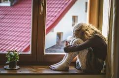 Sad child at the window Royalty Free Stock Image