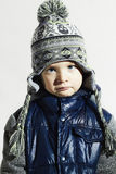 Sad child.winter fashion kids.fashionable little boy in cap Royalty Free Stock Images