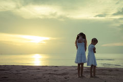 Sad children on the beach. At dawn time Stock Photography