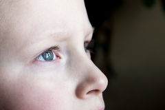 Sad children eyes. Close up - sad, upset blond boy teen Royalty Free Stock Photography