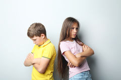 Sad children. On grey background Stock Images