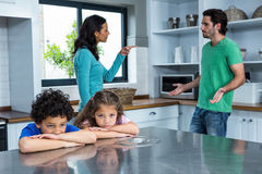 Sad children listening to parents argument. In the kitchen Royalty Free Stock Images