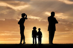 Sad children and parents turned away from each other. Conflict and divorce in the family. Sad children and parents turned away from each other Royalty Free Stock Photos