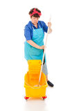 Sad Cleaning Lady. Sad depressed cleaning lady wringing out her mop in a bucket. Full body isolated royalty free stock image