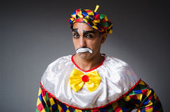 Sad clown against Royalty Free Stock Image