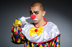 Sad clown against Stock Photos