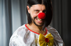 Sad clown against Stock Photo