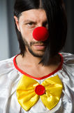 Sad clown against Royalty Free Stock Images