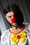 Sad clown against Stock Photography
