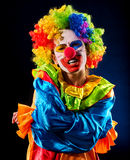 Sad clown on black background. Sick woman holds to stomach. Sad clown on black background. Portrait of sick woman holds on to stomach after performance Royalty Free Stock Photos