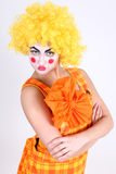 Sad clown in colourful costume Royalty Free Stock Image