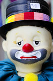 A plastic sad clown is for sale. A doll that is a clown for sale at a bargain price of $18.  Lake Okoboji, Iowa Royalty Free Stock Photos
