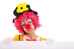 Sad clown holding a banner Royalty Free Stock Photos