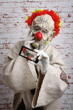 Sad clown makes selfie on cellphone. Royalty Free Stock Photo