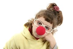 Sad clown nose little girl with big glasses Royalty Free Stock Photos
