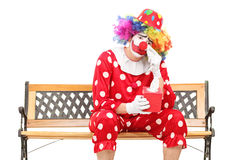 Sad clown wiping his eyes from crying. Isolated on white background royalty free stock photos