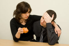 Sad couple. Young couple and empty money-box Royalty Free Stock Photo