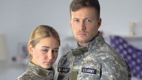 Sad couple of american soldiers looking camera closeup, dangerous profession. Stock footage stock video