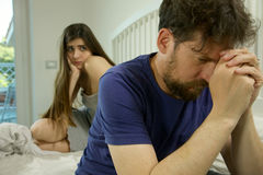 Sad couple in bed having problem breaking up Stock Images