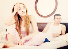 Sad couple in bed Stock Image