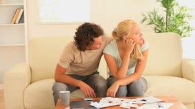 Sad couple checking at  their expenses Royalty Free Stock Photos