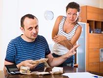 Sad couple counting budget Royalty Free Stock Photo