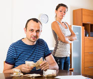Sad couple counting budget Royalty Free Stock Image